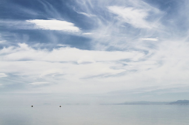 Distant kayakers in the Salton Sea near the North Shore Yacht Club
